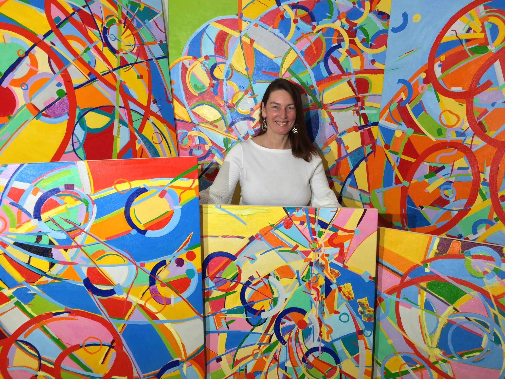 Dorit Brauer Standing with her paintings